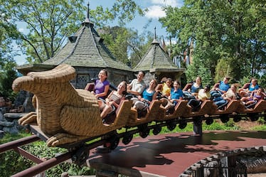 Young theme park guests and their families enjoying the mild roller coaster fun of Flight of the Hippogriff at The Wizarding World of Harry Potter in Universal's Islands of Adventure in Orlando.