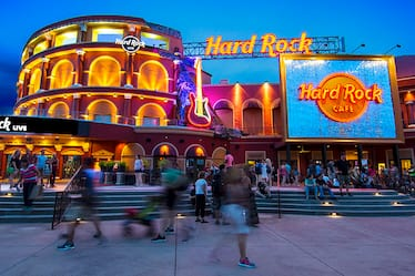 The exterior of the Hard Rock Live building illuminated at night at Universal CityWalk.