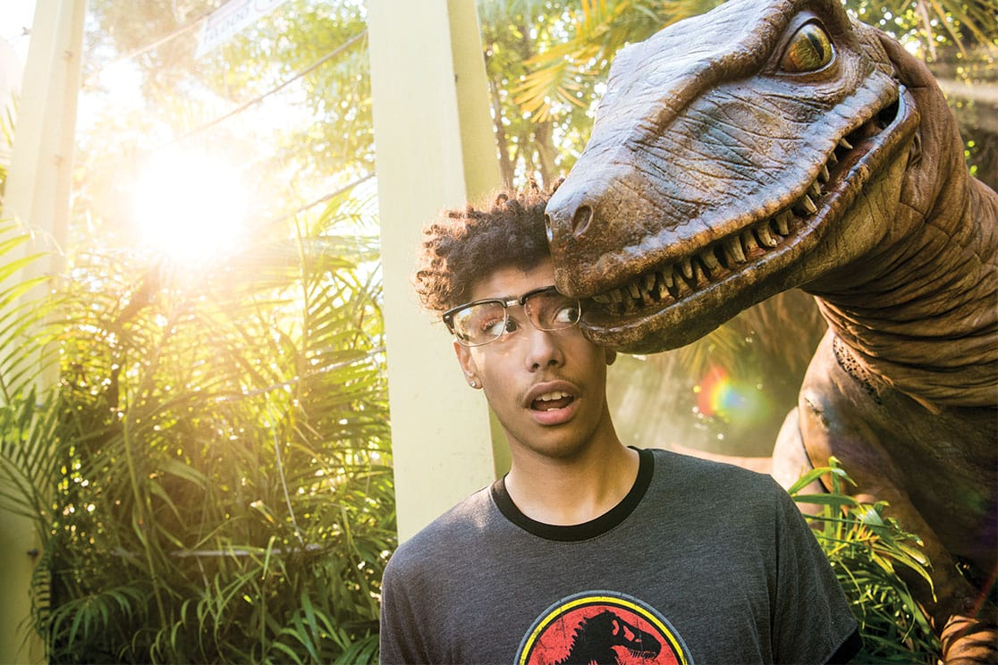 A raptor nuzzles a surprised teenager at the Raptor Encounter experience at Universal's Islands of Adventure.