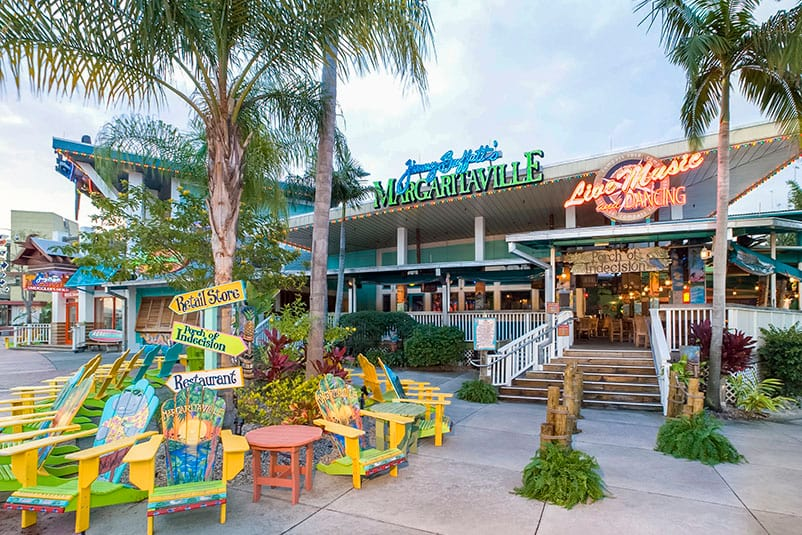 Palm Trees And Adirondack Chairs Create A Tropical Feel Outside Of Jimmy Buffett S Margaritaville At Universal