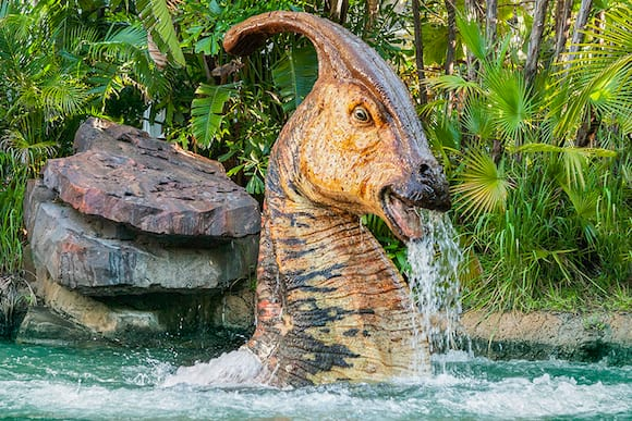 Jurassic Park River Adventure Fast Fact image 1, a dinosaur poking its head out of the water.