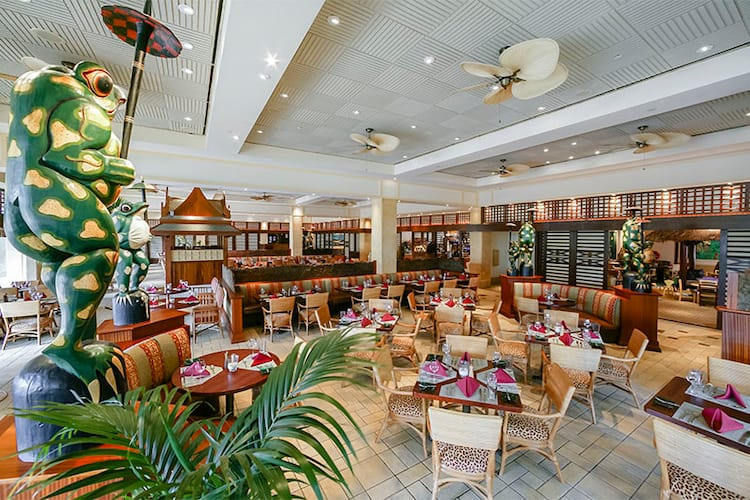 Animal print chairs and island decor define the Islands Dining Room restaurant at Loews Royal Pacific Resort.