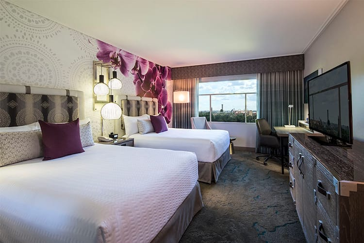 Two queen beds inside a Guest Room at Loews Royal Pacific Resort, a preferred on site resort hotel at Universal Orlando.