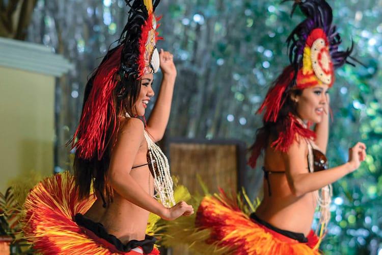 Dancers perform a Polynesian dance during the Wantilan Luau at Loews Royal Pacific Resort in Universal Orlando.