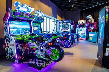 A group of lighted arcade games.