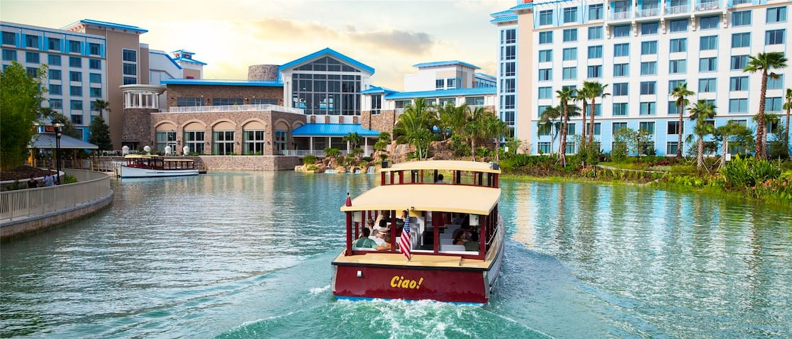 a water taxi cruises towards loews sapphire falls resort an on site resort hotel at