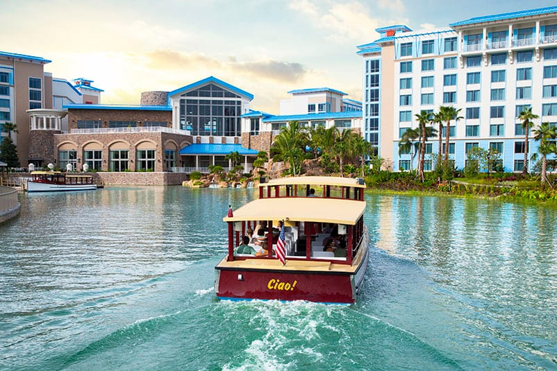 A water taxi cruises towards Loews Sapphire Falls Resort, an on site resort hotel at Universal Orlando Resort.