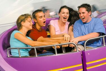 A group of guests working together to spin their ride vehicle on Storm Force Accelatron at Universal Orlando.
