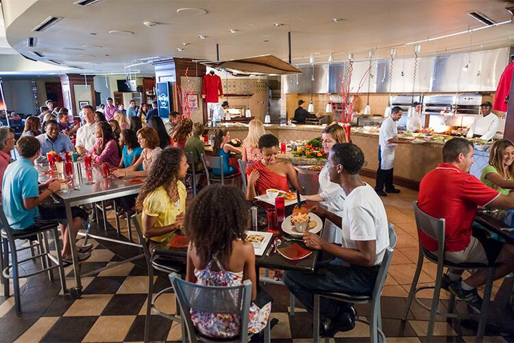 Groups of guests enjoying their time at The Kitchen, Hard Rock Hotel's restaurant that showcases classic comfort food dishes prepared with a rock star twist at Universal Orlando.