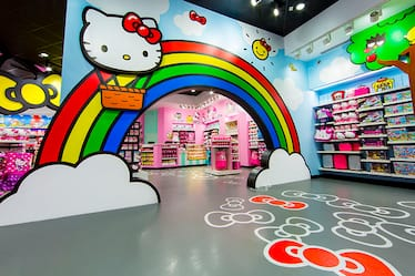 A large rainbow archway inside the Hello Kitty Shop Featuring Hello Kitty and Friends at Universal Studios Florida.