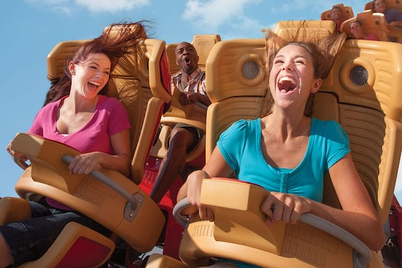 A close up image of two girls riding Hollywood Rip Ride Rockit roller coaster at Universal Studios Florida.