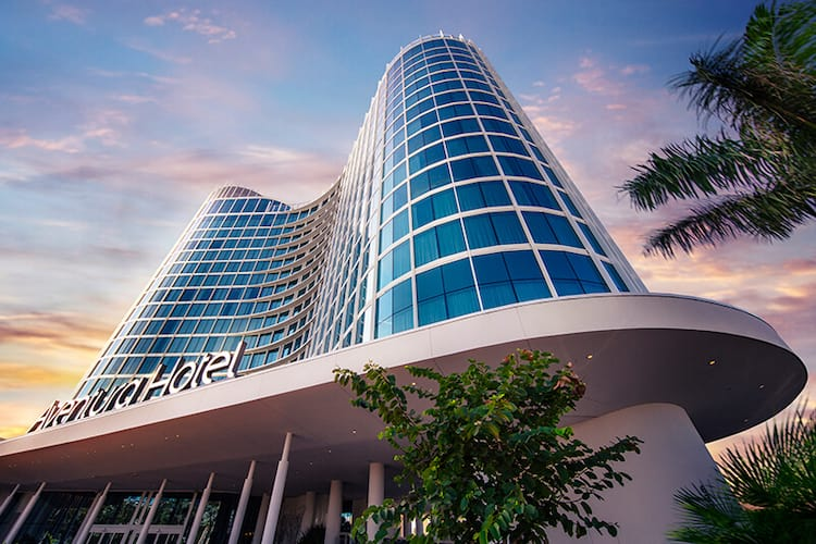 An artistic rendering of the back of Universal's Aventura Hotel and its exterior pool.